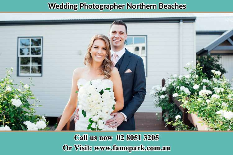 The Groom and the Bride in front of their house Northern Beaches