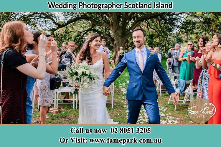 Photo of the Bride and the Groom showering bubbles by the visitors Scotland Island NSW 2105