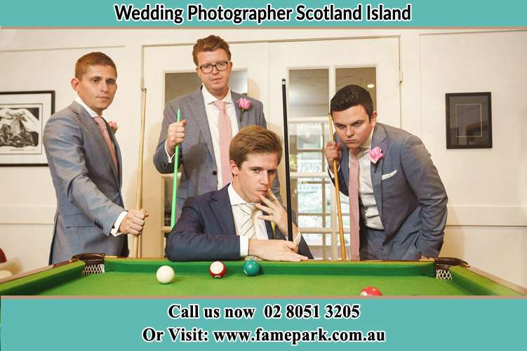 Photo of the Groom and the groomsmen playing billiard Scotland Island NSW 2105