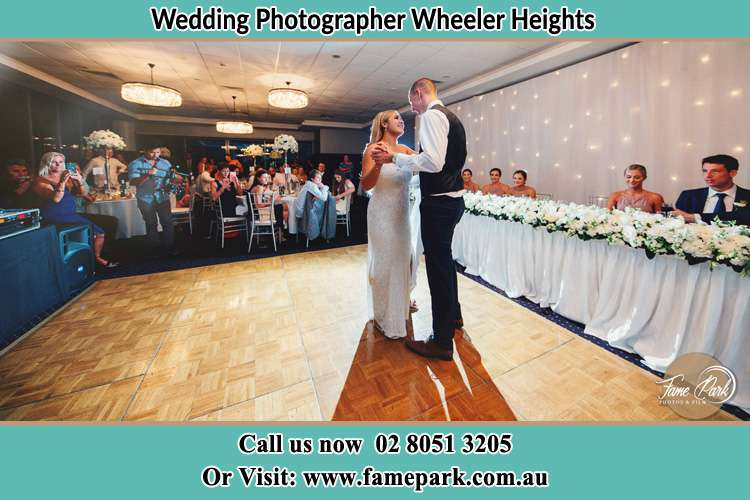 Photo of the Bride and the Groom dancing Wheeler Heights NSW 2097